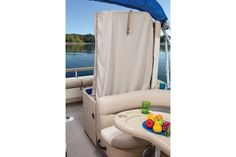 No need leaving the pontoon to change on the NEW 2015 Sun Tracker Fishin' Barge 22 DLX there is a change room hidden underneath the back bench