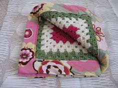 Such a cute idea, granny square blanket with fabric on the other side.