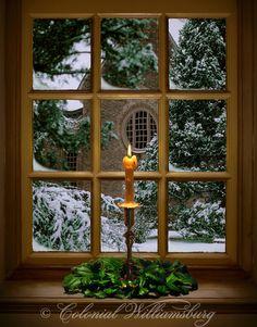 Single Candle lighting the window