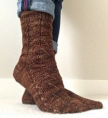 Twig and Branch sock pattern - free until September 21, 2014. Lovely lace pattern that is appropriate for just about anyone.