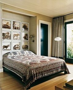For a touch of bohemian, Filicia snagged a bedspread in the Philippines and fashioned a headboard out of animal prints cut from a book.