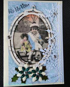 Nostalgische Weihnachtskarte,  kleines Mädchen auf dem Schlitten