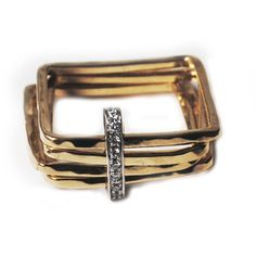 https://www.cityblis.com/9665/item/10578 | Square ring with diamonds - $1232 by Larissa Landinez | Inspired by Japanese architecture this set of 4 square rings delicately shaped and curved by hammering and linked by a non fixed white gold rectangle with a Pave setting of diamonds  Simple and clean design is a timeless piece to wear giving a unique and elegant style.   The different square sha... | #Rings