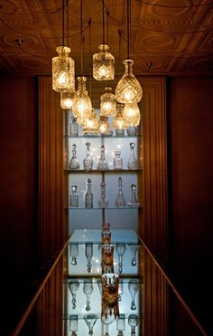 Pendant lights using vintage decanters @Bailey Francine Coe you could do this with wine bottles too I'll bet!