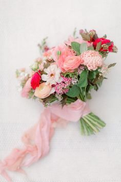 This pink bridal bouquet includes tones of blush, peach, coral and raspberry pink flowers. Locally grown #calgary flowers include butterfly ranunculus, ranunculus, anemones, yarrow, china aster and snapdrqgons. This hand tied bouquet was finished with pink silk ribbon tails. #pinkbouquet #weddingbouquet #engagementbouquet #engagementflowers #summerweddingflowers #summerweddings #summerweddingideas #anemones #butterflyranunculus  Photo: Juno  Photo Planning: @momentsbymadeleine… Flower Girl Bouquet, Bridal Bouquet Pink, Hand Tied Bouquet, Bouquet Toss, Bridesmaid Bouquet, Wedding Bouquets, Anemones, Ranunculus, Aster