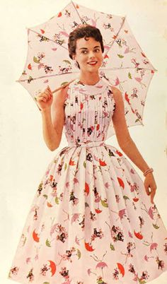 """The year 1955 was a year of what might be termed """"siren simplicity"""" in women's fashions. Clothes combined willowy sex appeal with fresh youthfulness and ease."""