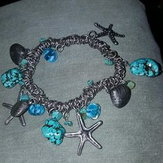 Upcycled art glass and turquoise bracelet Made of some vintage pieces, real turquoise and charms and strung on elastic. Will fit a larger rest as I have a 7 inch wrist and it is very loose on me. Vintage Jewelry Bracelets