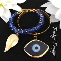Dark blue Evil Eye bangle gold plated. Handmade by PathysDesign