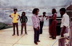 Super rare photograph from '76 of BOB MARLEY talking with tour road manager. Behind him, NEVILLE GARRICK, BUNNY WAILER, LEE PERRY and ALAN COLE © Kim Gottlied-Walker