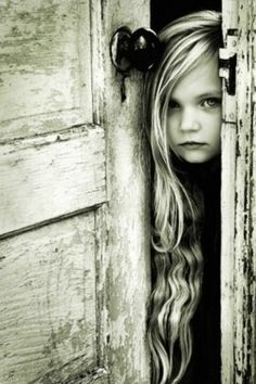 Young girl with long hair.  Such a pretty picture