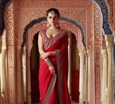 Rangoli Georgette Silk Saree in Maroon Color. Enhanced with Fency Thread, Hand Work, and Lace Border Work. Available with a Un-Stitched Banglori Silk With Fency Thread Work And Sequnce With Dori Work Blouse, Crafted in Round Neck and Short sleeves. Designer Saree Blouse Patterns, Indian Designer Outfits, Indian Sari Dress, Indian Dresses, Saree Trends, Red Saree Wedding, Indian Bridal Outfits, Indian Fashion Saree, Indian Bridal Fashion