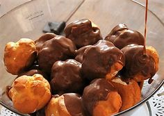 Ingredients: 1 package of bigna (choux pastry balls, the same you'd use for St. Honoré cake) 500 ml sweet cream  For the ganache: 150 g sugar 250 g dark chocolate 60 g flour 8 egg yolks 25 g butter 1 vanilla pod 1 l milk  Method: Cut the vanilla pod lengthwise and add to a pot of milk. Bring the milk to a