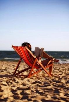 reading on the beach in a lounge chair