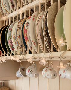 Lovely shabby plate rack with mis-matched vintage china. Gorgeous