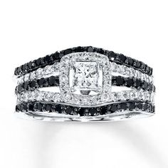 A brilliant princess-cut diamond framed in round diamonds is the sparkling centerpiece of this contemporary engagement ring. A row of round Jared Vivid® black diamonds is bordered above and below by additional round white diamonds, while the matching cont