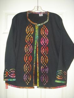 Amazing reverse applique sweatshirt jacket. The colors are amazing and the celtic knotwork is stunning. Her hands must be sore after all that intricate cutting.  by judychou2, via Flickr