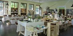 TEH Naturwerke Verkaufsraum am Steinpass in Unken Table Settings, Table Decorations, Shopping, Furniture, Home Decor, Retail Space, Traditional Bathroom, Decoration Home, Room Decor