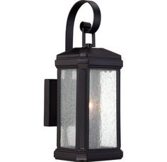 """View the Quoizel TML8405 Trumbull 1 Light 15"""" Tall Outdoor Wall Sconce with Seedy Glass at LightingDirect.com."""