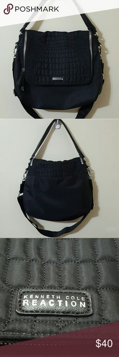 Kenneth Cole Reaction Crossbody Purse 👜Black exterior with gray interior 👜Adjustable, removable crossbody strap  👜Exterior pocket with snap closure  👜Multiple interior compartments with built-in card holders  👜100% Nylon  👜100% PVC 👜 A few tears on short strap; otherwise in great condition Kenneth Cole Reaction Bags Crossbody Bags