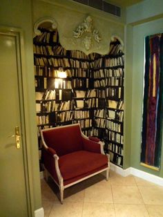Got a too small to live-in room area? Make it a reading space with book shelves on three walls.