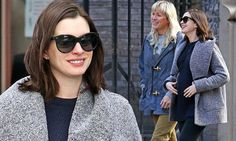 Pregnant Anne Hathaway looks cozy as she walks to lunch with friends