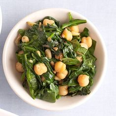 This is no ordinary wilted spinach recipe--it's dressed up with shallot, pine nuts, and garbanzo beans for a tasty side dish for meat or chicken.