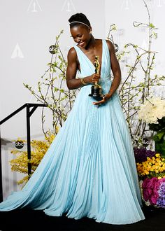 "Lupita Nyong'o poses in the press room with the award for Best Actress in a Supporting Role for ""12 Years a Slave"" during..."