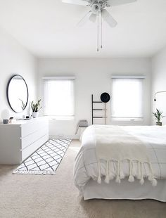 Tips for styling a modern and Scandinavian interior. Light and neutral monochrome bedroom.