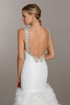 Ivory lace fit and flare bridal gown, V neckline with scalloped detail, low back with beaded accents, full textured skirt and chapel train Bridal Gowns from Lovelle By Lazaro - Bridal Style LL4504 by JLM Couture, Inc.