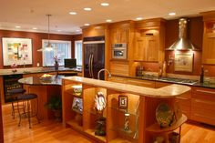 Large Kitchen - natural cherry cabinetry, two granite countertops, island seating, glass display shelves, sink in island,