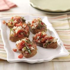 Bruschetta with Prosciutto Recipe -A crowd-pleaser any time of year, this savory-tasting recipe is perfect for get-togethers.—Debbie Manno, Fort Mill, South Carolina