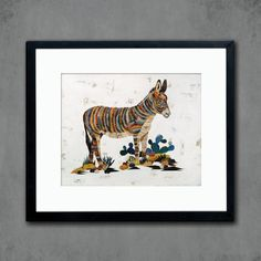 A burro donkey grazes in a small cactus patch in this delicate, colorful paper collage reproduced as a high quality giclee print on paper.