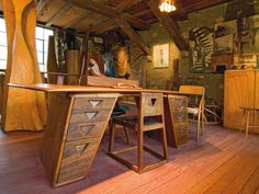 Wharton Esherick desk inspired by a sawhorse table witnessed at an artists' cooperative show in New York. From Homes of the Master Wood Artisans, photo Steven Paul Whitsitt.