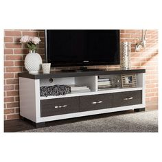 Update your viewing space with an entertainment unit that easily suits classic and modern decors. Oxley TV Cabinet is a versatile design with a warm wooden look and appealing functionality. A TV stand with three drawers and open shelving space, Oxley TV Unit is a stylish storage solution for all your media devices. Made from durable engineered wood with an exquisite two-tone white and dark brown embossed laminate finish and accessorized with silver hardware, Oxley TV Unit will add class and…