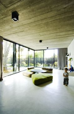 Wood ceiling + burnished concrete floor fusion.