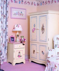 A luxury Beatrix Potter nursery roomset designed by Dragons of Walton Street. Roomset includes Small Wardrobe, Bedside Cupboard, Asccot Chair, Bespoke name picture and bespoke curtains.   www.dragonsofwaltonstreet.com