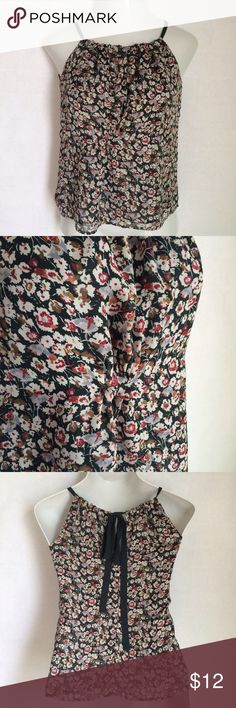 """✨NEW Listing✨Gap floral tank with adjustable ties Adorable Gap tank/halter top with an adjustable neckline and ties in back. Pretty all over floral pattern. Is gathered in front, under bustline, to give some feminine shaping. Fits loose. Could fit up to a S, as well. Shown on mannequin with 35.5"""" bust. Size is XS. 100% polyester. Not interested in trades. GAP Tops Tank Tops"""