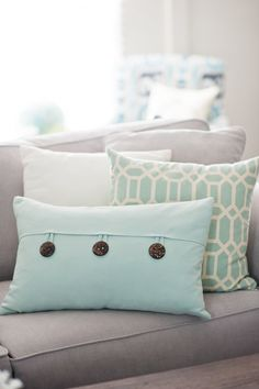 Got to copy these scatter cushions  Read more - http://www.stylemepretty.com/living/2013/09/16/diy-playbooks-home-tour-from-gina-cristine/