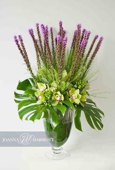 Purple liatris and green cymbidium with variety foliage. www.joannamarriottflowers.co.uk @joannamarriott