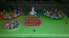 One last look at the treat/cake table for beach birthday party. Made flip flops from nutter butters, super easy!