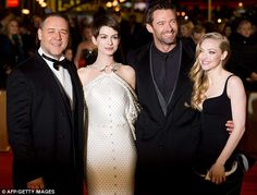 Anne Hathaway looking every inch the Hollywood star on the red carpet at the premiere of Les Miserables, alongside co-stars Russell Crowe, Hugh Jackman and Amanda Seyfried...