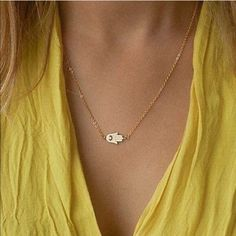 Gold Hamsa Necklace Gold tone necklace with a hamsa charm. NO TRADES Jewelry Necklaces