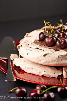 Chocolate pavlova, chocolate cream and fresh cherries – a plate full of chocolate sugary deliciousness.