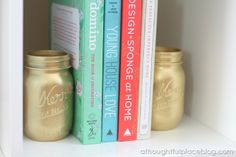 spray-painted mason jars as book ends! definitely doing this. and I need the Young House Love book (on my amazon.com wish list.. hint, hint) to go in between them!