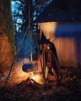 Witch's Cauldron   Martha Stewart Living - Suspend a steaming pumpkin from long branches to form a wickedly creepy cauldron.
