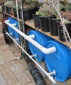how to make a rain barrel harvesting system