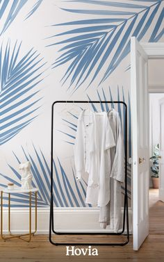 Want to add a bit of tropical bliss into your interior? Our Azure mural is a playful take on palm leaf wallpaper that's ready to refresh your room with its ocean-blue hues and white backdrop. These large-scale, photographic palm leaves are arranged in a way that gives your room an impressive focal point, full of vibrant blue plants to frame your wall and any furniture nearby. Palm Leaf Wallpaper, World Map Wallpaper, Tropical Wallpaper, Forest Wallpaper, Beach Wallpaper, Childrens Shop, Blue Plants, White Backdrop, Bespoke Design