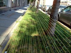 Urban Artist veronika tzekova 'space nrgzer #4 soft benches' 2010 is an installation of strings attached to public benches in biella, italy.