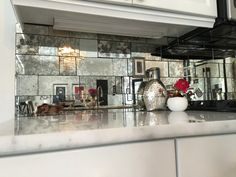 antique mirror backsplash installed in different tile sizes | home