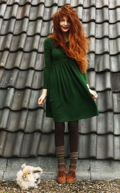 Long-sleeved emerald green dress, colorful knit leggings over black tights, and leather moccasins. Little house on the prairie revamped! :)